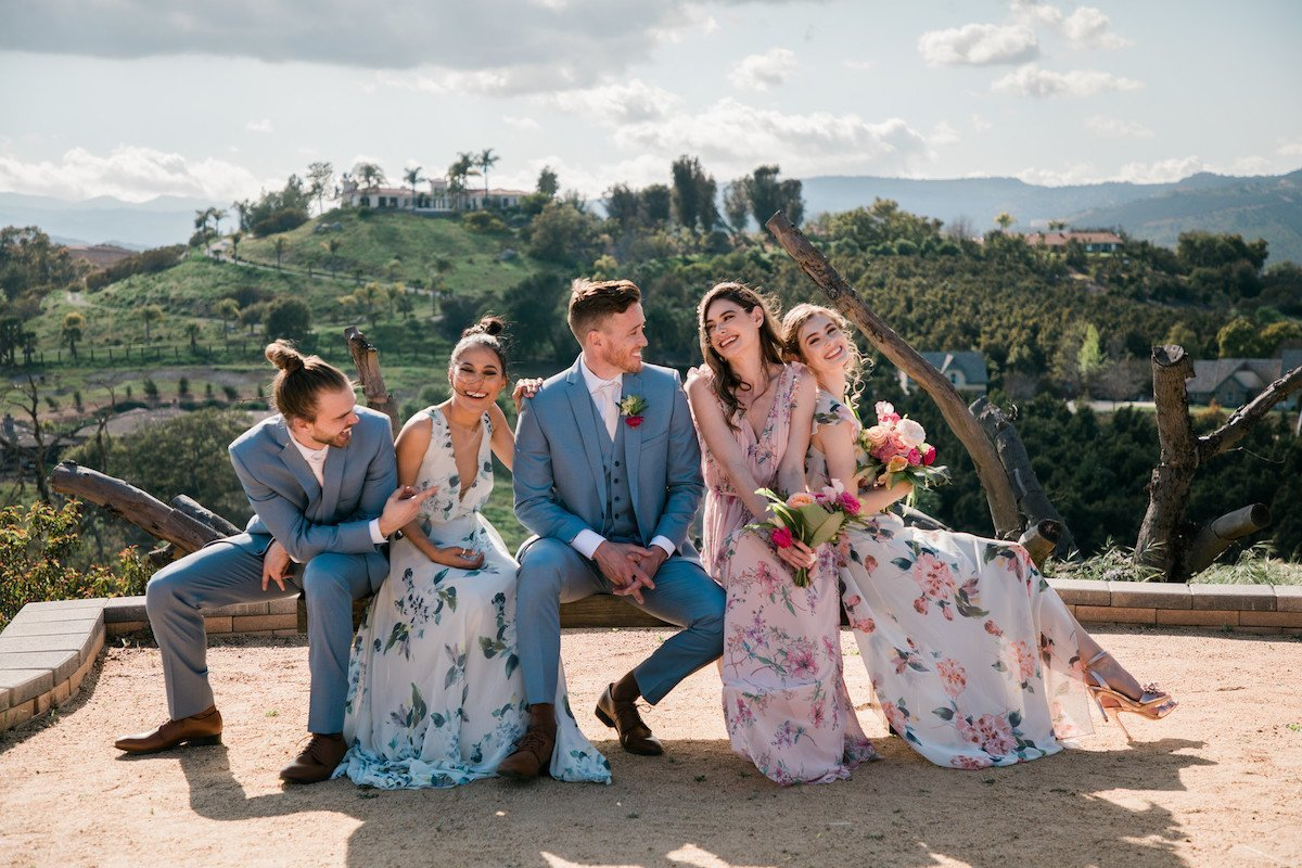 Bridemaids and groomsmen wearing beautiful floral gowns at Emerald Peak in Temecula