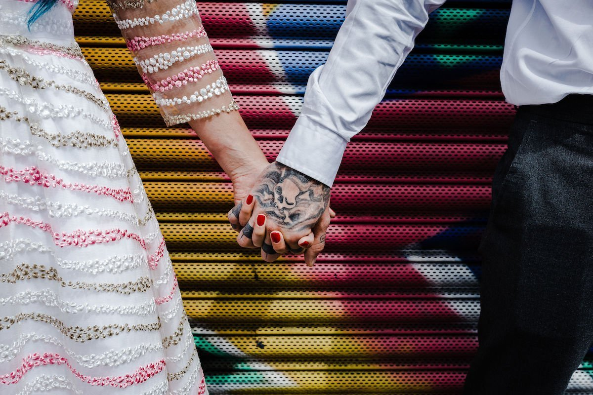 unconventional urban wedding, bride and groom with tattoos and piercings